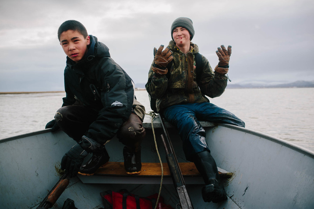 Peter Lockuk Jr. and Jim Logusak (not pictured) pick up Jim's brother Travis Logusak (l) and Brekin Gosuk (r) from the Togiak Bay shore east of town after an unsuccessful duck hunt.