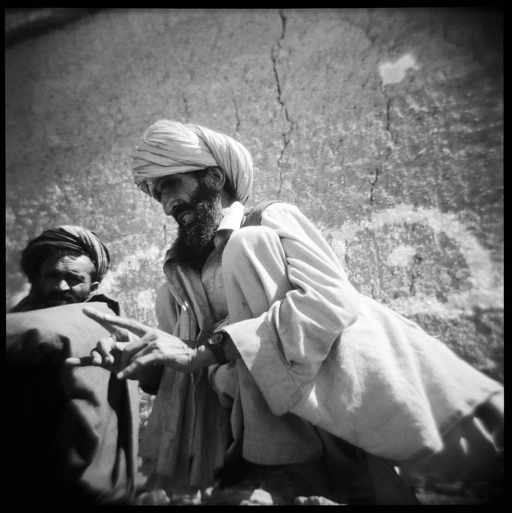 An Afghan man discusses insurgent intimidation of locals to soldiers of Dog Company, TF White Currahee 2-506 Infantry, 4th BCT, 101st Airborne Division in Gayan District, Paktika Province, Afghanistan. 2011.