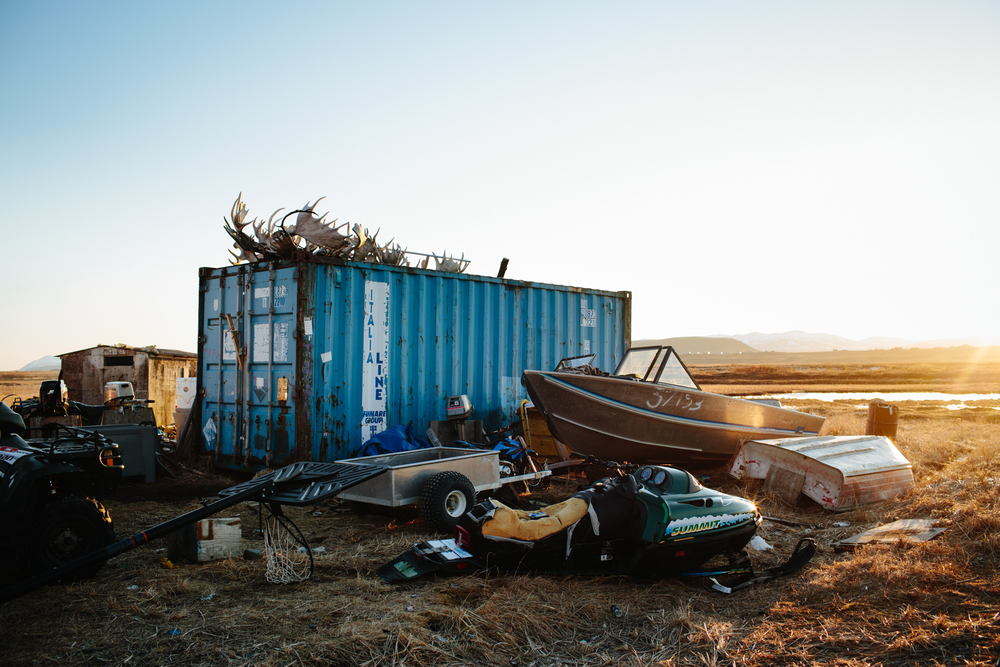 Remnants of broken snowmobiles, ATVs, and boats behind a home in Togiak, Alaska, April 21, 2015. Transportation into the surrounding wilderness areas is critical for hunting and fishing, especially in towns off of the road system.