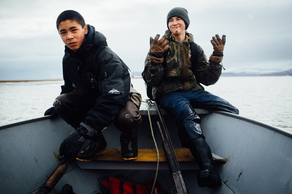 Peter Lockuk Jr. and Jim Logusak (not pictured) pick up Jim's brother Travis Logusak (l) and Brekin Gosuk (r) from the Togiak Bay shore east of town after an unsuccessful duck hunt. For Newsweek.