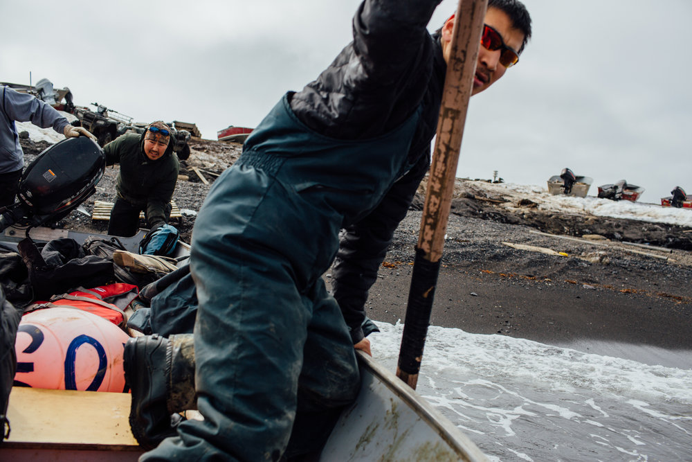 Hunters in Savoonga, Alaska launch their aluminum skiff from the beach in search of minke whale.