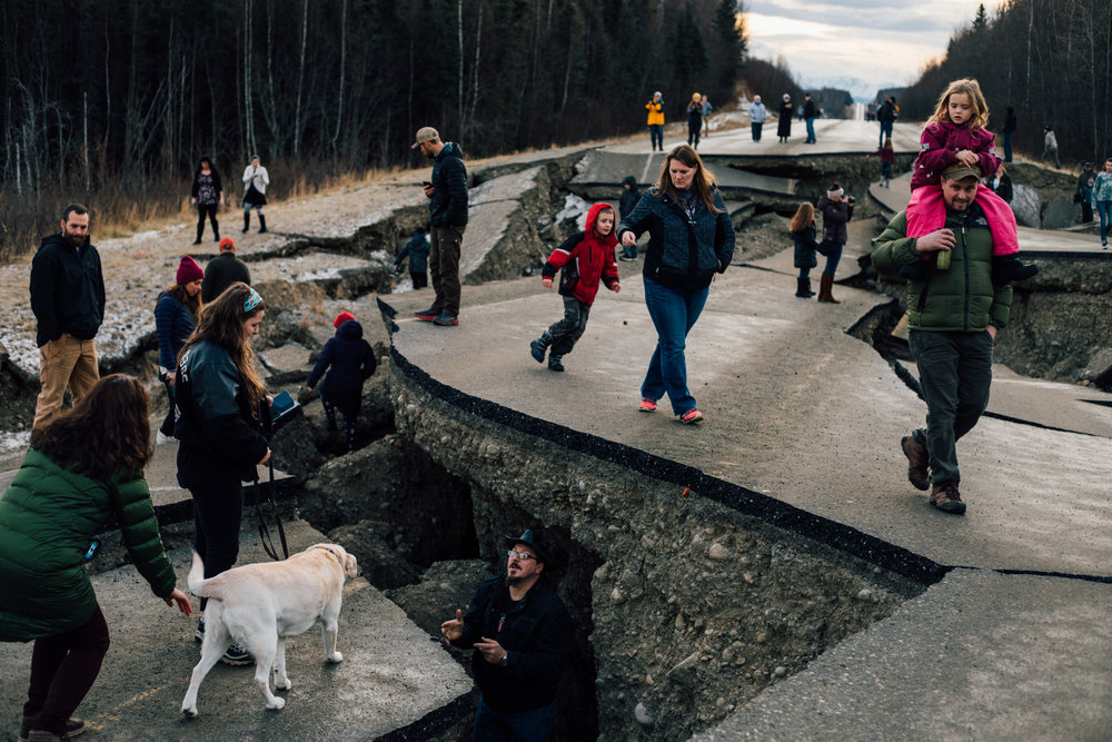 Residents of Wasilla, Alaska, exploring the earthquake damage to Vine Road on Sunday, Dec 2. The 7.0 magnitude quake that struck on Friday was centered nearby. For the New York Times