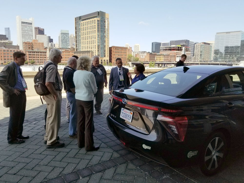 Geri Yoza, Toyota North America's Fuel Cell Vehicles Manager, discusses the Toyota Mirai FCV with state legislators at the NCSL Summit.