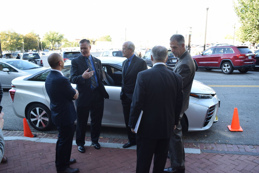 Congressmen Stivers (second from left) and Poliquin (center) discuss the Toyota Mirai Fuel Cell with Toyota and FCHEA representatives.