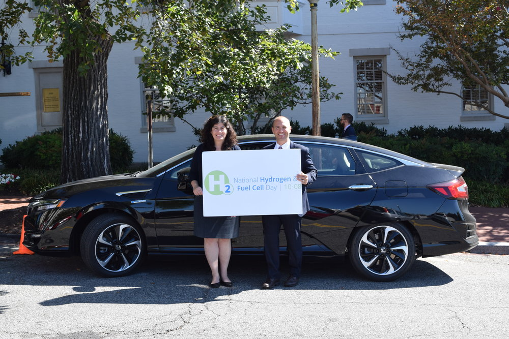 Representatives from Honda and FCHEA pictured with the Honda Clarity Fuel Cell.