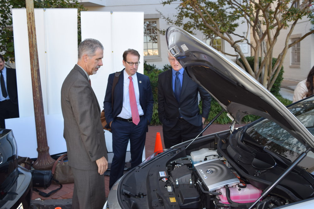 Congressman Peter Roskam (center) examining under the hood of the Toyota Mirai Fuel Cell.