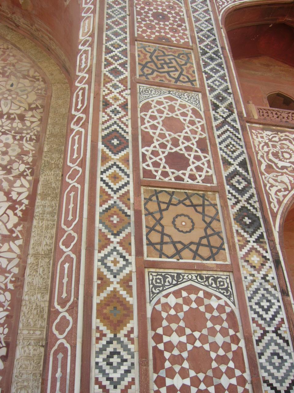 Detail of marble and sandstone inlay.