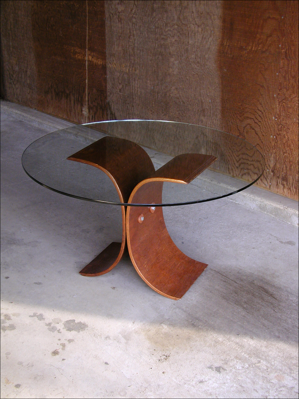 "Laminated Plywood Coffee Table: 1/8"" birch plywood, custom walnut washers, varnish, glass  24""R x 30""H"