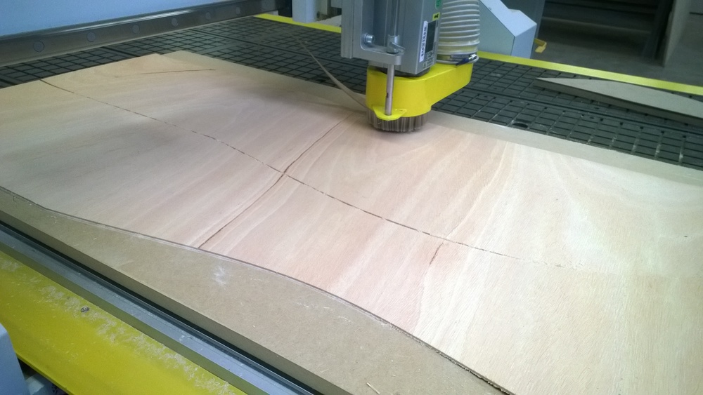 CNC:   I used a CNC router to cut out eight pieces from my quarter inch bending ply which gave each side of my stool four pieces to make the stool an inch thick all around.