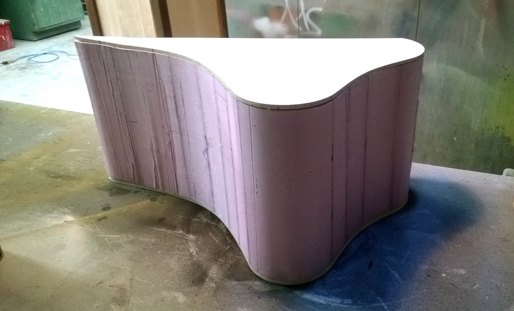 Form Creation:   I created a foam mold of half of my stool to wrap my bent pieces around in order to vacuum bag them to hold the complex shape.