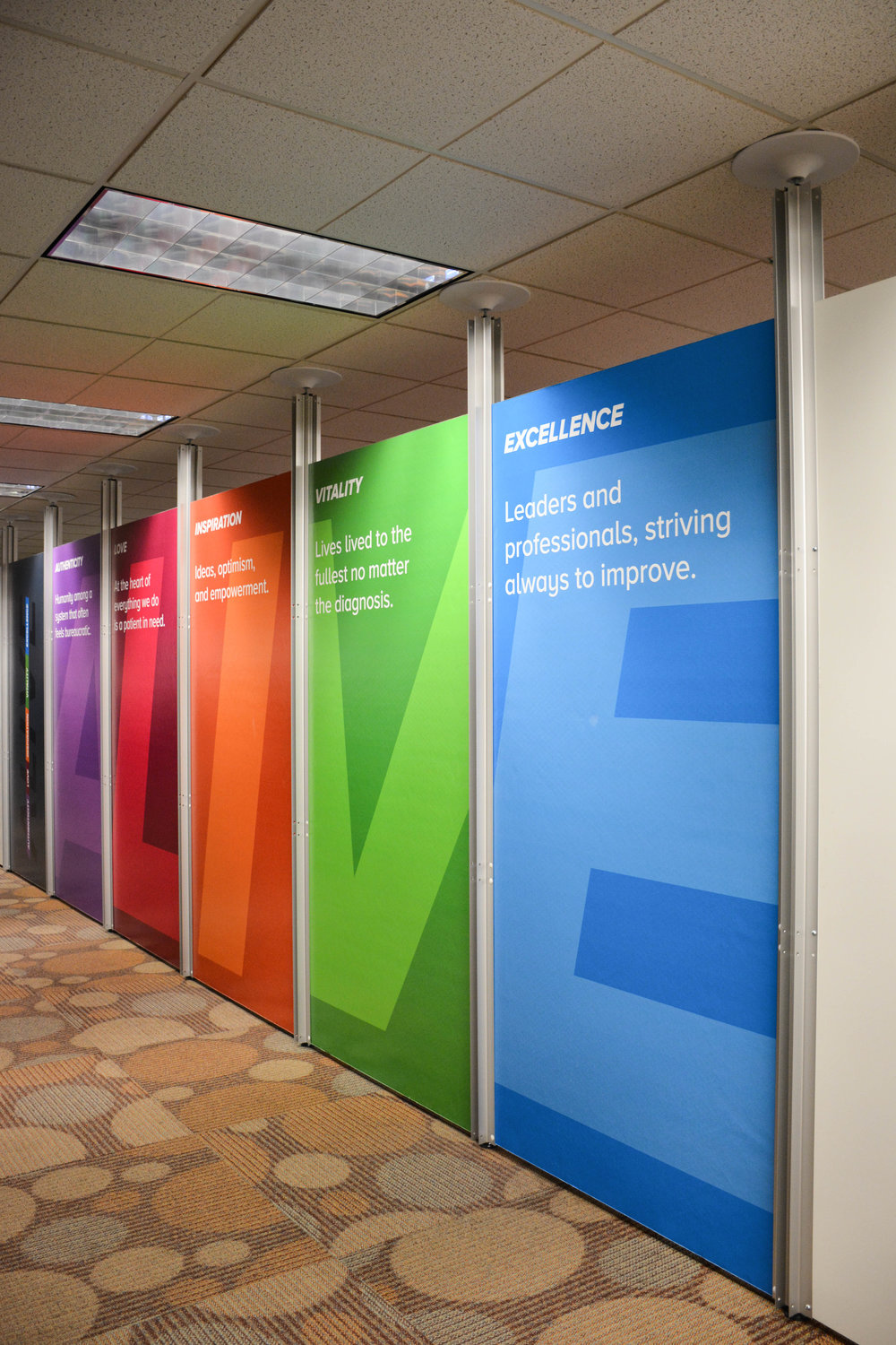 Temporary divider wall with printed foamboard graphics.