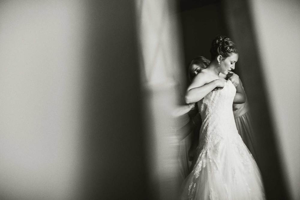 Kristen putting on her wedding dress at First Congregational Church in Columbus, OH.