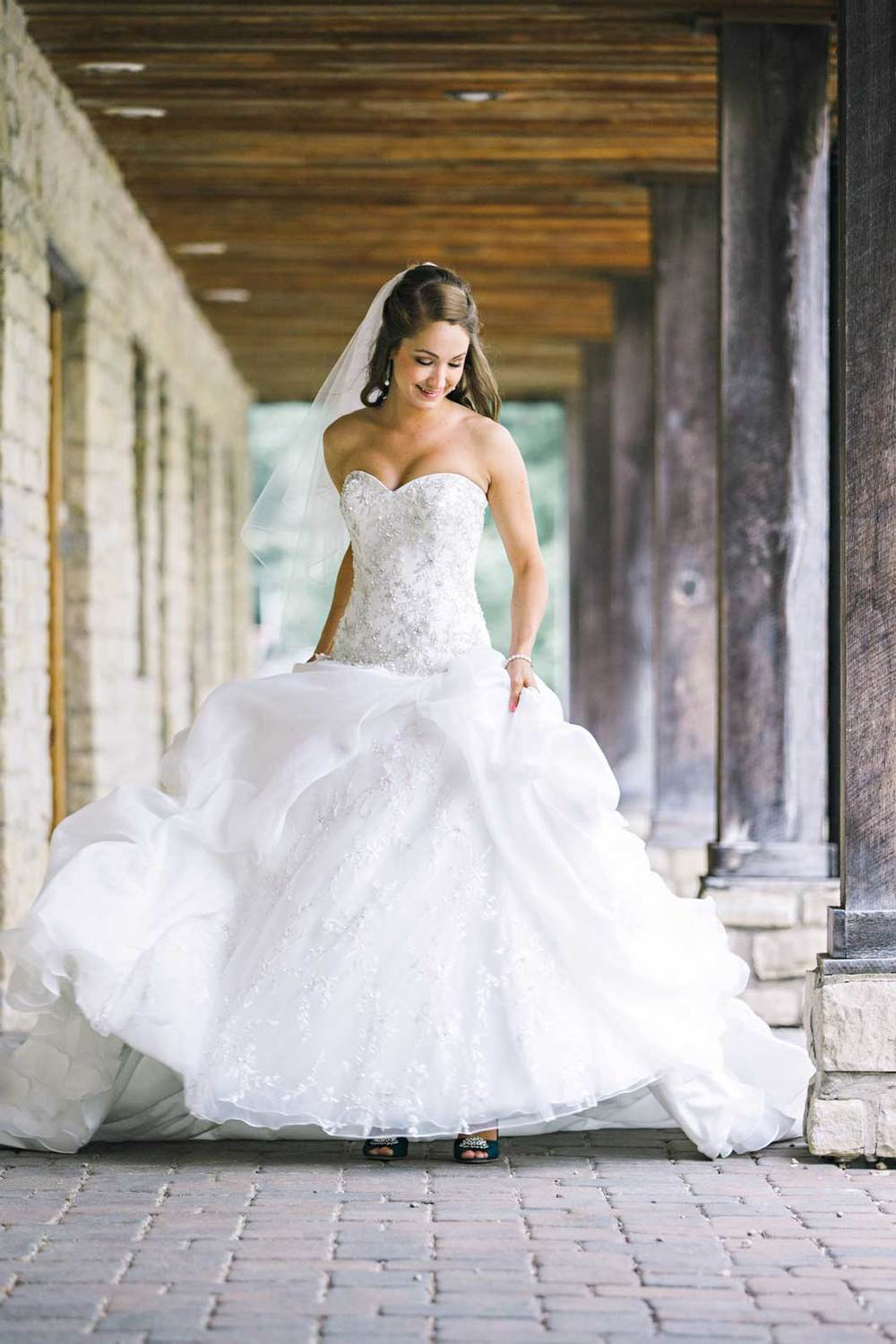 Bride spinning in dress at Liberty Presbyterian Church in Powell, Ohio