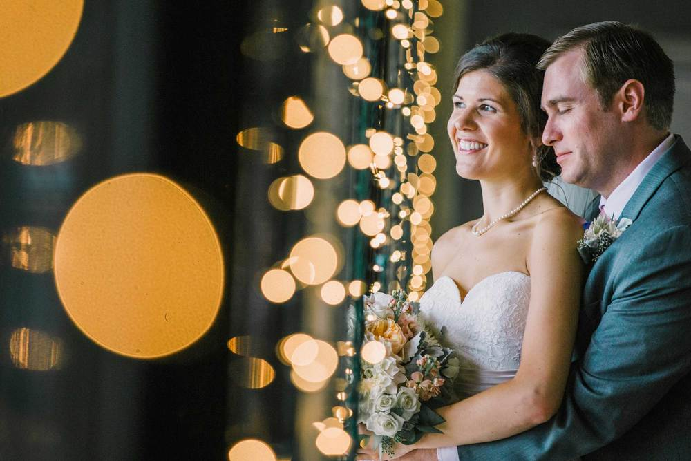 Bride and groom hide from the rain in the reception venue at the Zanesville Country Club