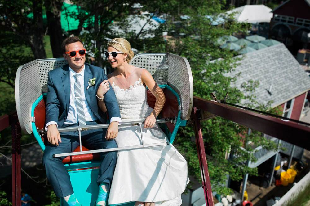 Bride and groom on the ferris wheel at Geneva on the Lake in Ohio