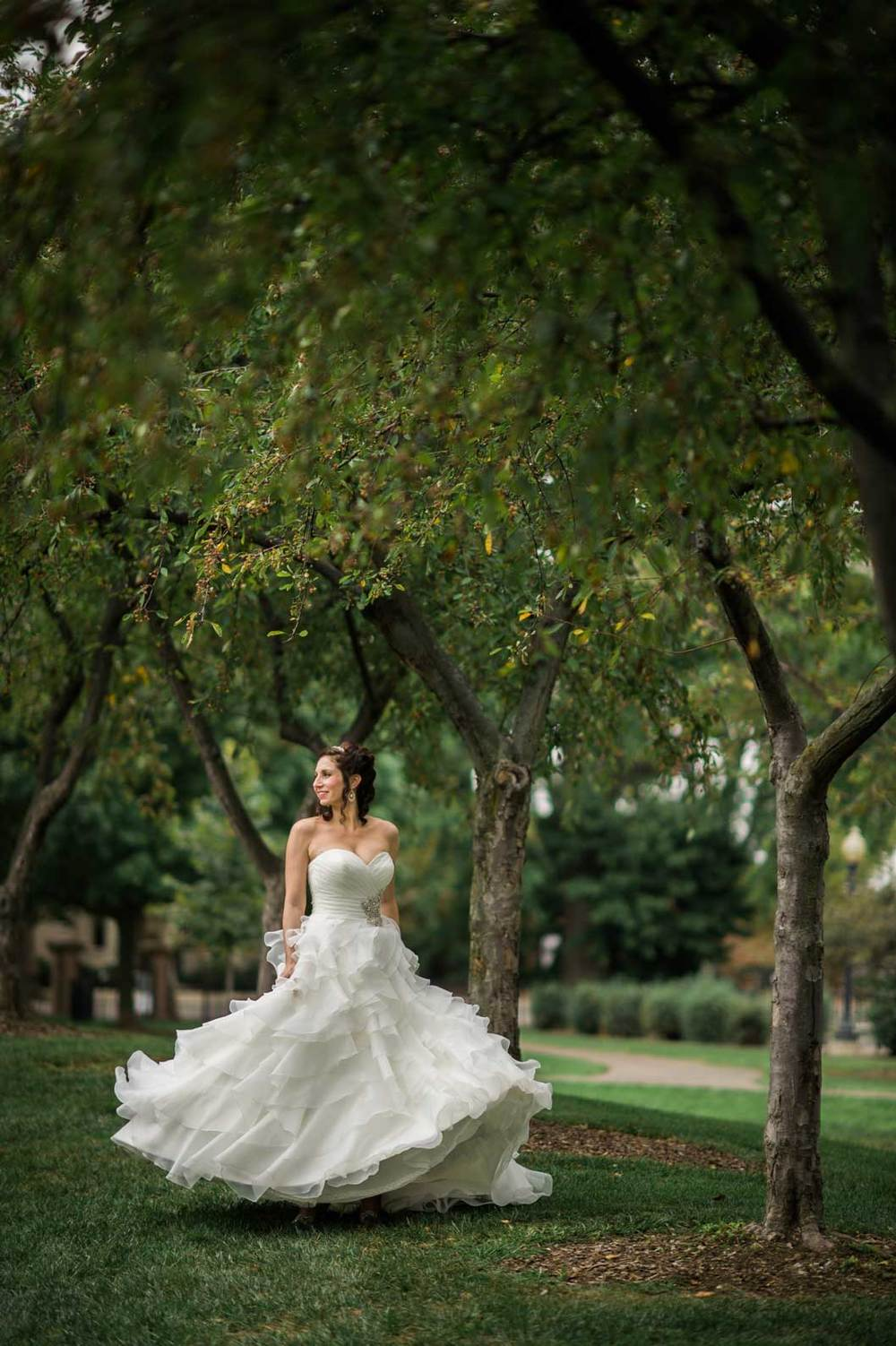 A bride spinning in her dress in the Topiary Park in Columbus, OH