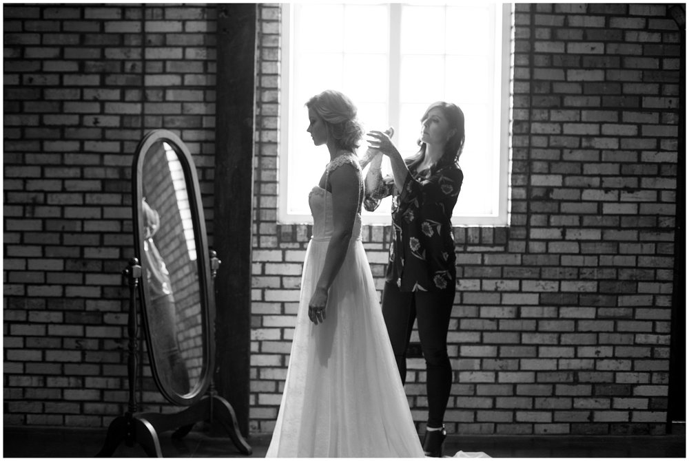 finishing touches on bride