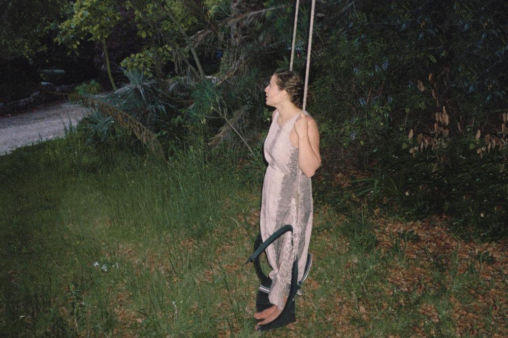 Kristen, swinging.