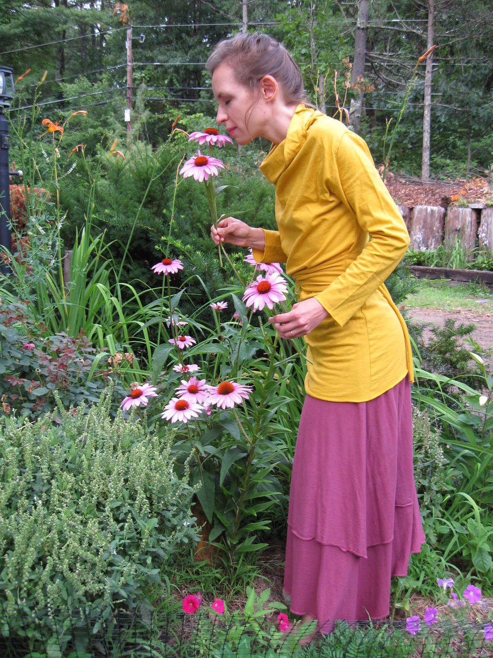 "Erin: I n the flower garden wearing the Cocoon Shirt & my favorite clothing item ever, the Vinyasa skirt, which I fondly call "" Skirt Perfect "". It is wonderful to be in nature wearing such truly natural & beautiful clothes!"