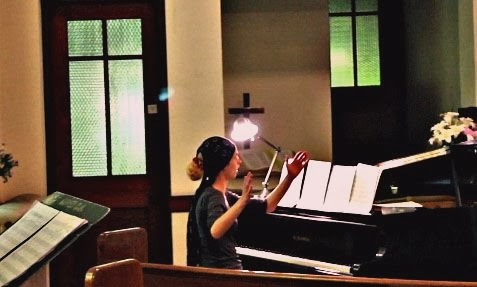 "Jessie conducting ""Talismane"" at Peace Community Church, Oberlin OH"