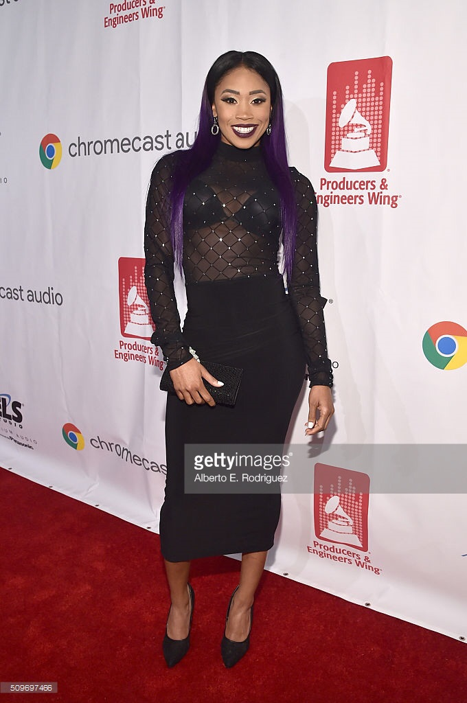 "E!  Total Divas  reality star Ariane Andrew in the IMME COLLECTION ""Glamour"" Dress at the 58th GRAMMY P&E Wing Event."