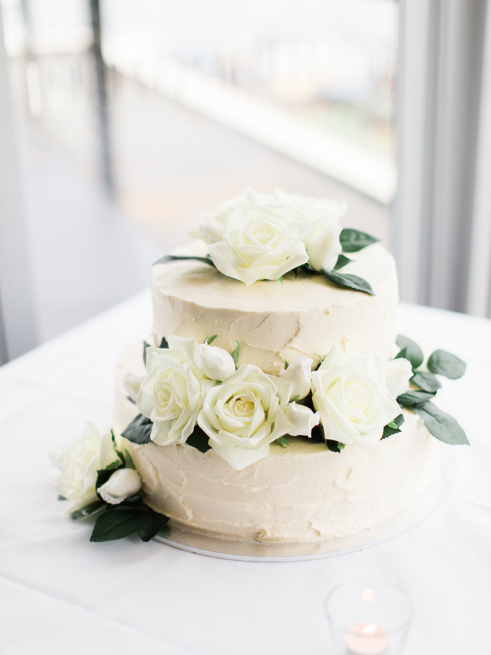 Salted caramel mud cake w/ vanilla bean 'rustic' buttercream frosting Photo Credit: We Are Origami Photography