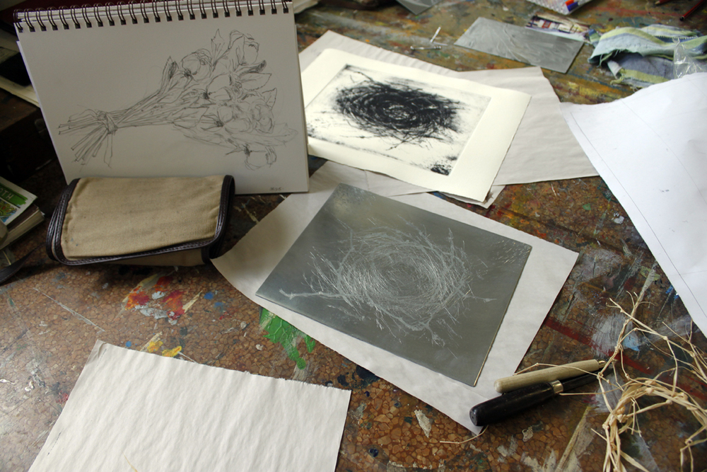 Barbara's work table with her first etching of a nest.