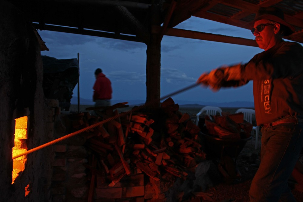 prokos raking the coals.jpg