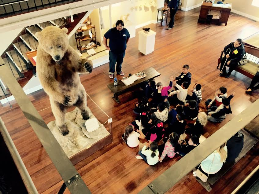 Martin Morones speak with a group of school children in the Heritage Gallery.