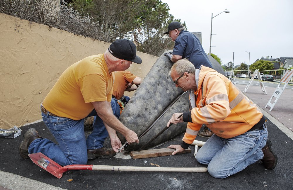 """The grand finale was to align all eight sections seamlessly. The City's PW crew completed all facets of the restoration except the need for mobile welders. Sand City's """"Coastal Fabrication Company"""" installed the new custom piece. Larry, Arlon and Roque recorded the date 'July 18, 2018' on the piece — a hallmark to the ingenuity, skill and camaraderie involved in the restoration."""