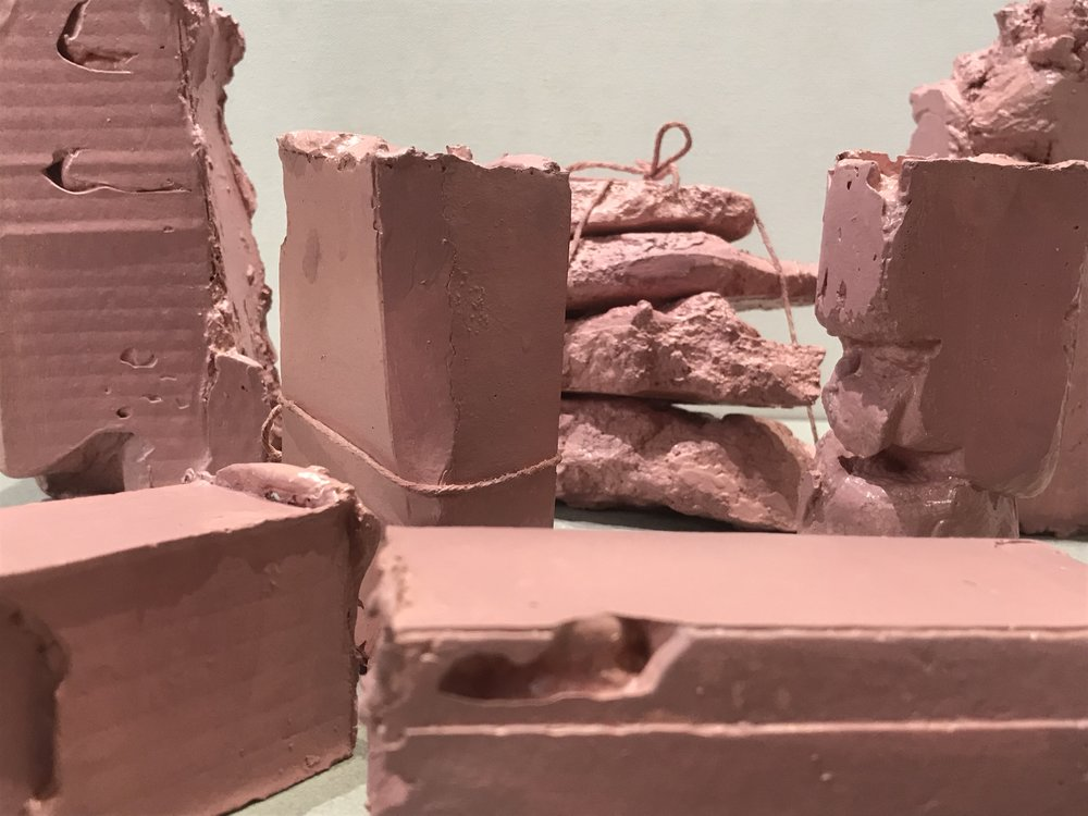 "Flesh Packages,  painted plaster, string collection of pieces each varying 6""H X4""W X 3""L (2018)"