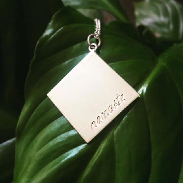 NAMASTE: The key is to respect each other. ✨ Shop our Unity collection over on www.catmeffan.com. ❤️ Thank you @laurabradyyoga for posting this photo of our Namaste pendant. 🌱🌿🍃