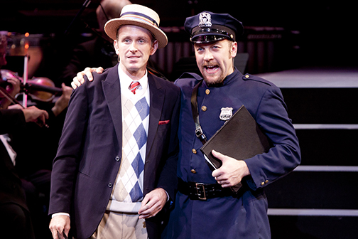 Ben Davis as Antipholus of Ephesus and Alexander Gemignani as Police Sergeant in the Shakespeare Theatre Company's production of  The Boys from Syracuse , directed by Alan Paul. Photo by Scott Suchman.