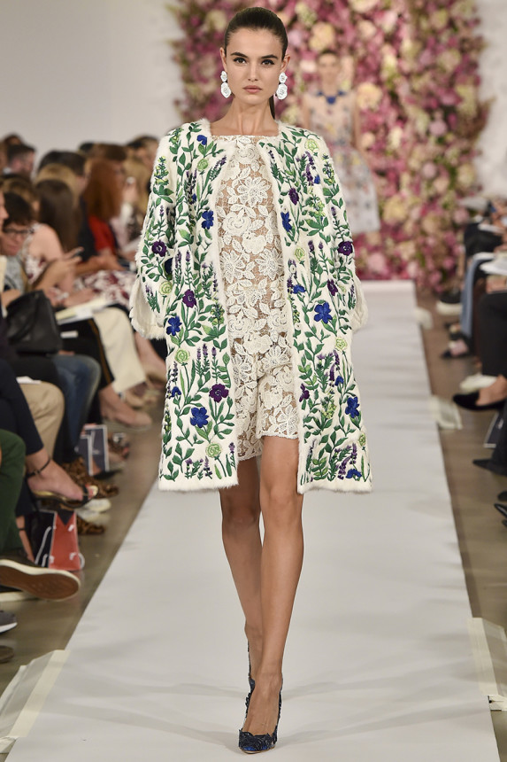 Oscar de la Renta    Sigh, literally that's what I did when viewing Oscar's entire Spring line. So beautiful and feminine, all of the looks were just outstanding. This coat is unique and makes the lovely lace dress look even more beautiful underneath.