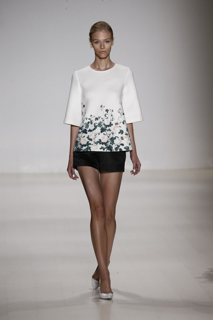 Erin   Fetherson     There is something so sexy about a black short with pumps. While much runway fashion tends to be the opposite of versatile, these shorts would match with anything, including this pretty floral top.