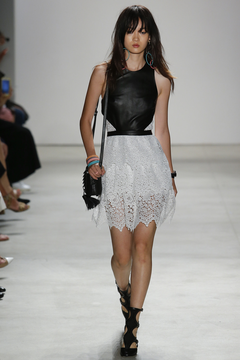 Rebecca Minkoff    The leather and lace contrast is really pretty! This look has both an edgy and feminine vibe to it, which is awesome—it's the best of both worlds. The red lipstick polishes the whole thing off with a bit of glam.