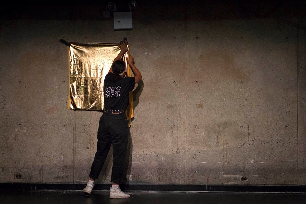 Rad was last to perform. After working for 2 hours and finishing sweeping, they taped up a gold piece of fabric in which to express themselves in front of.