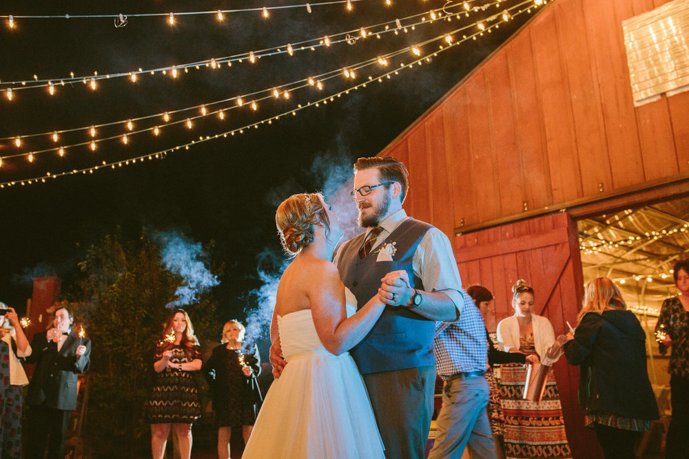 Since Nick and Melissa had a small wedding, they opted to have their guests surround them with sparklers during their first dance instead of doing a sparkler exit.