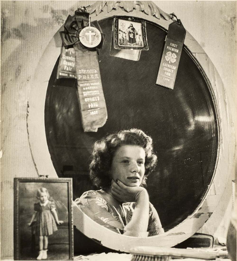 "Esther Bubley, Untitled (Beauty, junior grade: the largest red ribbon on Norma's mirror was won 11 years ago in the Saunders County ""better baby"" contest), n.d.; Gelatin silver print, 14 x 11 in.; Gift of Jill and Jeffrey Stern; © Jean B. Bubley; Photograph by Lee Stalsworth"