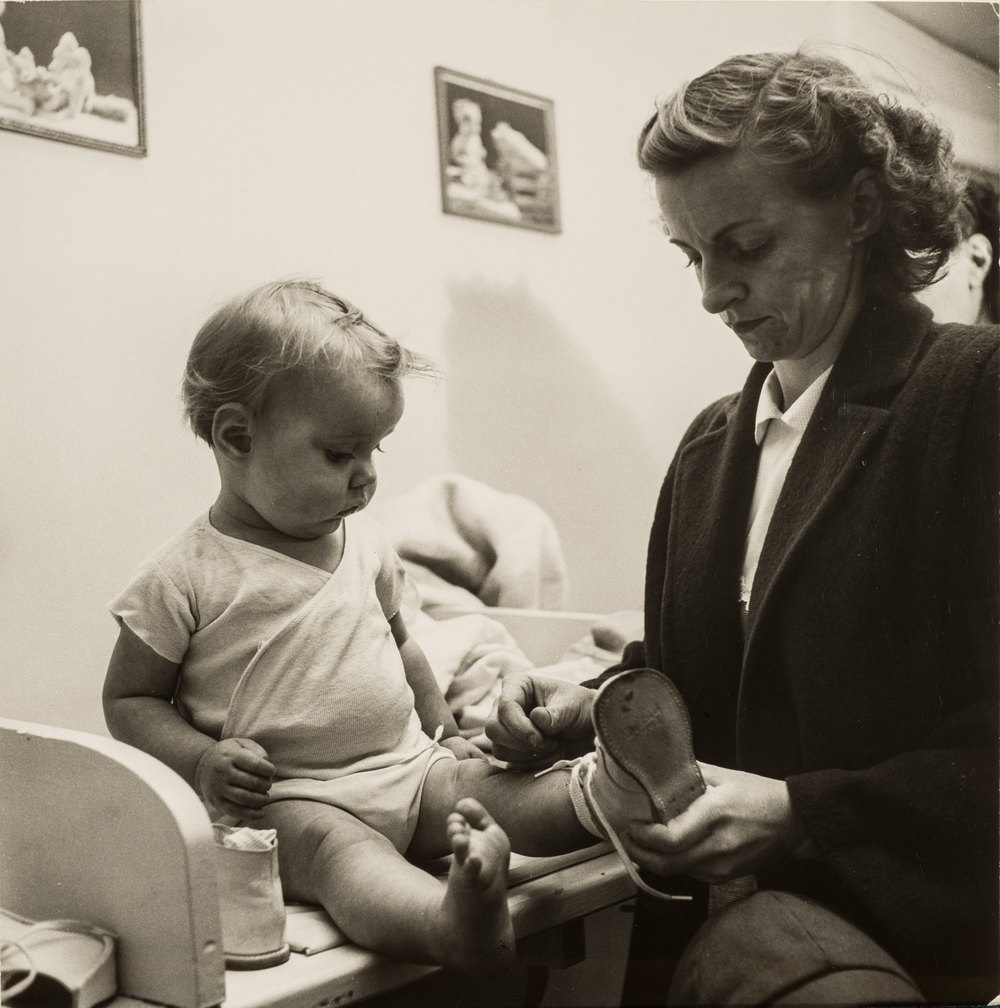 Esther Bubley, At the well-baby clinic, 1953; Gelatin silver print, 7 5/8 x 7 1/2 in.; Gift of Kenneth and Lori Polin and Family; © Standard Oil (New Jersey) Collection #76624; Photographic Archives, University of Louisville; Photograph by Lee Stalsworth