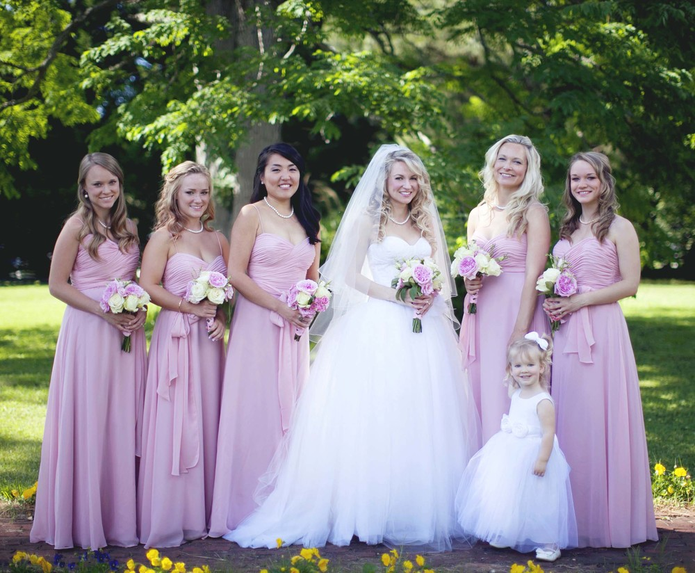 Jennifer's bridesmaids were her 4 sisters and her friend from college