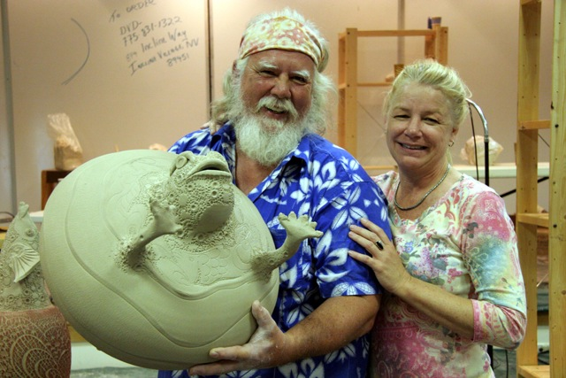 Main presenter, Randy Brodnax holding his piece which he created at the 7th Biennial Mid-Atlantic Clay Conference, with an attendee Gail Adkisson. Photo by Rex Looney.