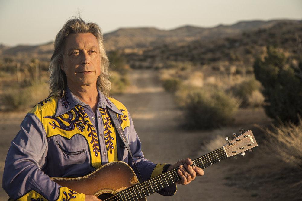 Still - Jim and guitar in California Desert.jpg
