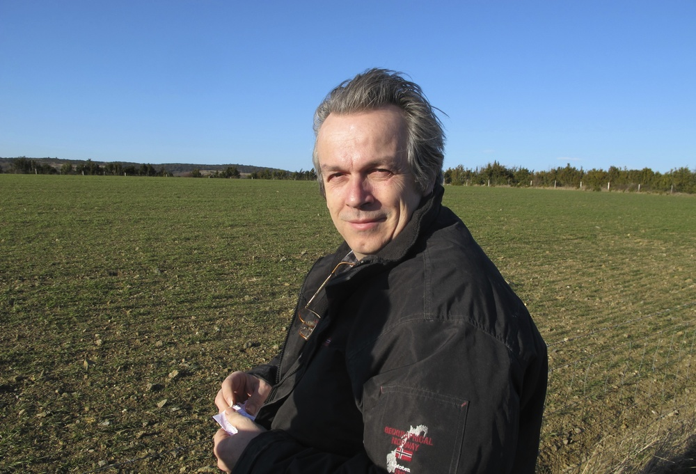 Ronald Feuillas in front of a young field of ancient wheat in southwest France