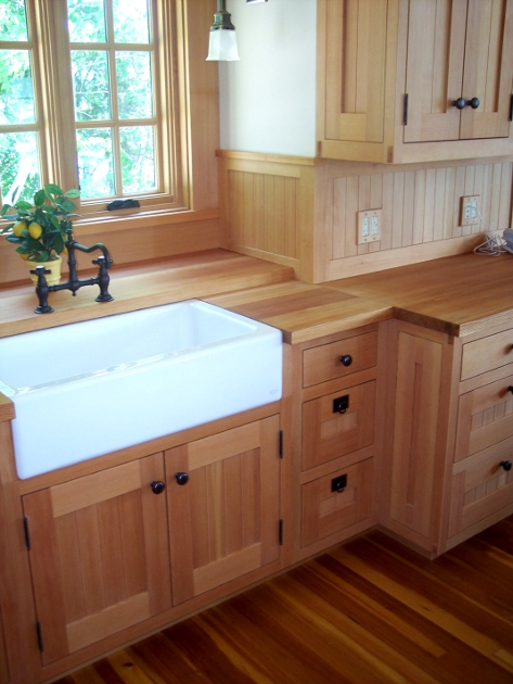 Classicly styled cabinetry in Douglas fir is matched with a antique-style sink and faucets in a kitchen overlooking Canandaigua Lake.