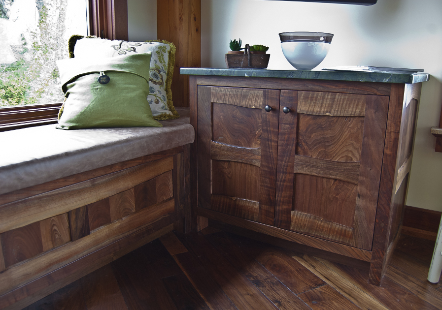 Custom crafted of Claro Walnut, this bench and cabinet provide extra storage space in the family room. Both pieces feature live edge stiles and rails.