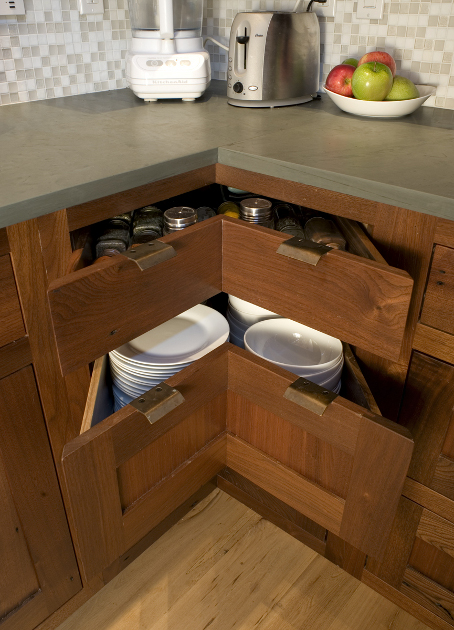 Custom reclaimed walnut corner drawers offer more storage space.