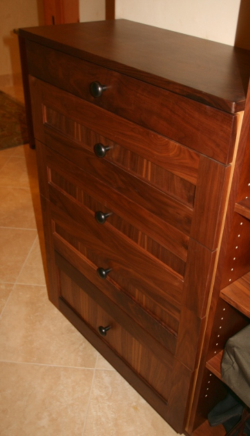 Custom closet drawers in walnut.