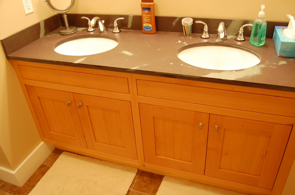 This Douglas fir vanity features a custom slate top from Vermont.