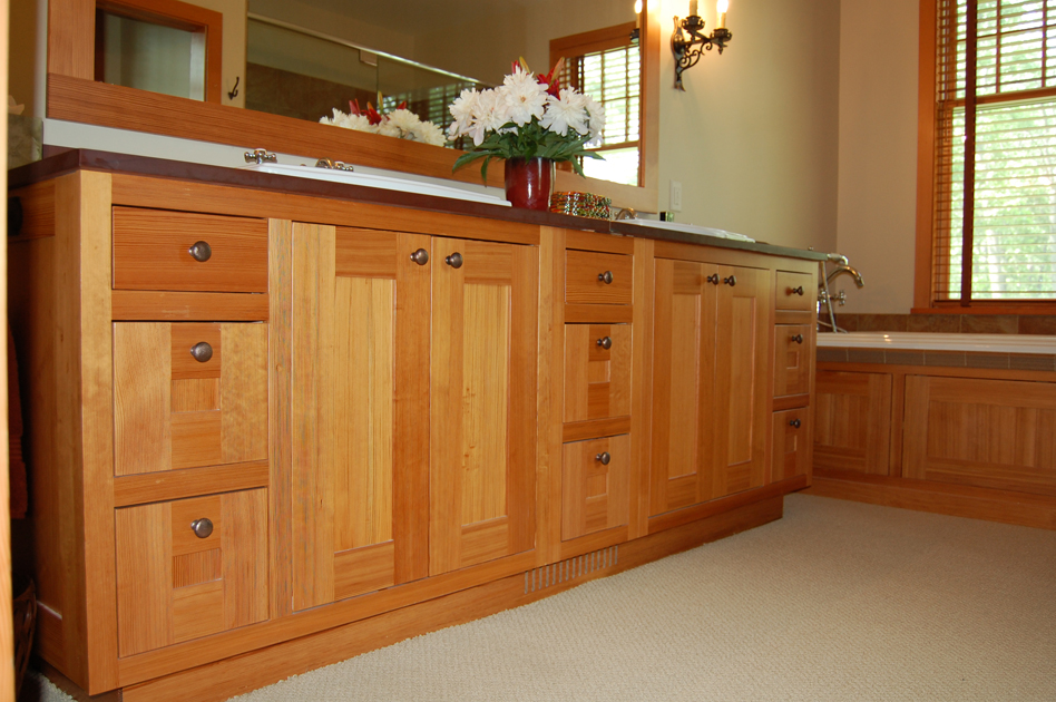 Vertical grain antique heart pine vanity and tub surround.